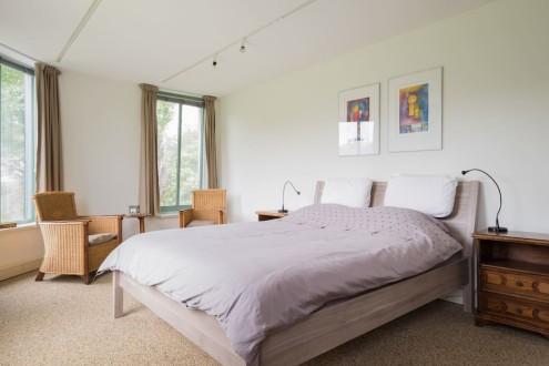 Koetshuis slaapkamer tweepersoonsbed